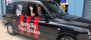 Carita driving the KFC branded car